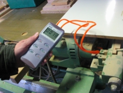 The PCE-P15 Differential Pressure Meter measuring presure in an industrial machine